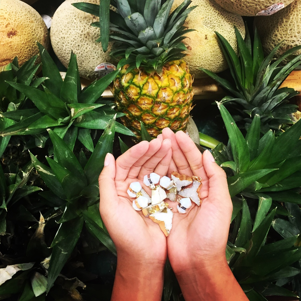 Checking out the pineapples and our new pendants at the farmer's market.