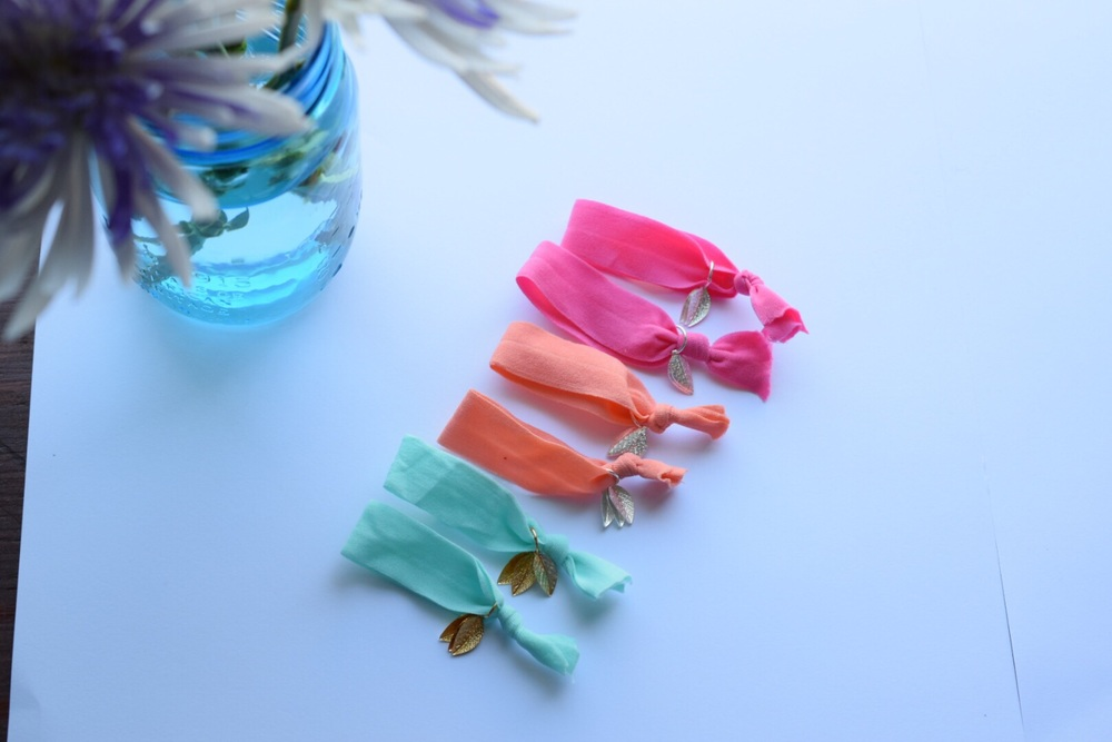 Adding these free neon hair ties to each summer purchase.