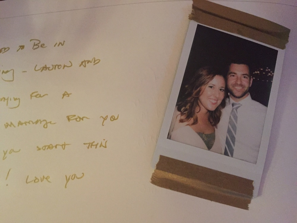 Polaroids in the guest book.