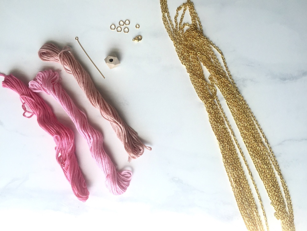 Materials: gold chain, small gold jump rings, clasp, gold wire/eye pin, wood bead, pink embroidery thread