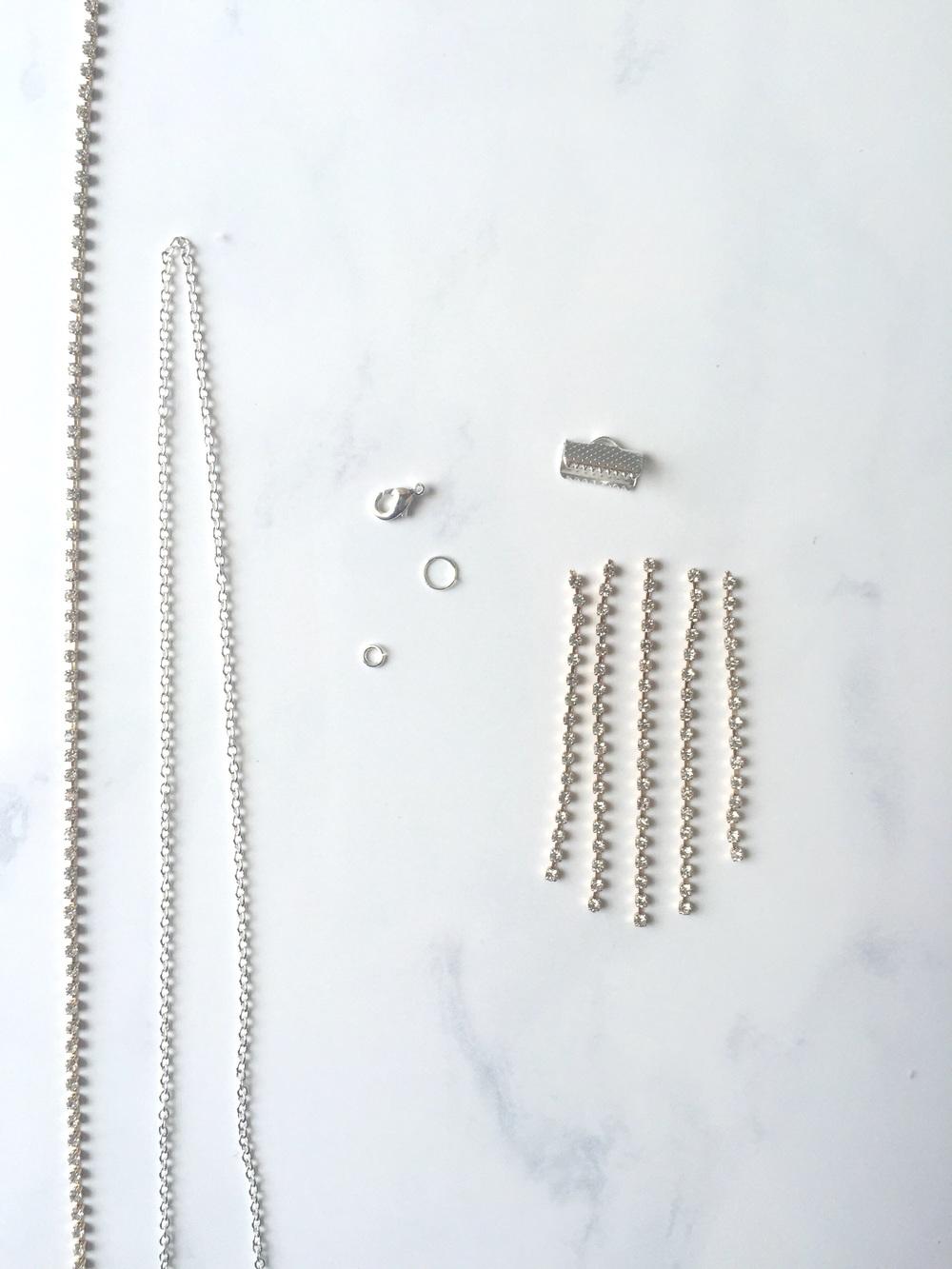 Materials: silver chain, rhinestone chain, silver jump rings and clasp, silver clamp bail.