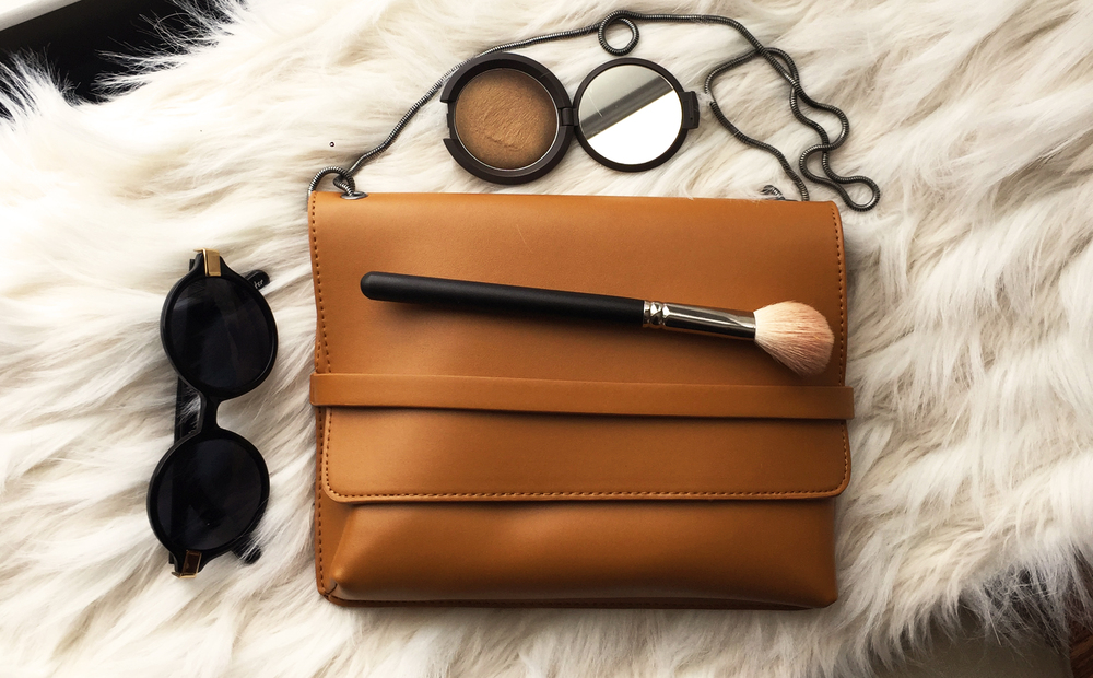 From L-R: Elizabeth & James  Wooster  c/o Shop Ditto, Becca Shimmering Skin Perfecter in Poured Cream Topaz, MAC Cosmetics 163, Silence + Noise Handstrap Bag ( on sale! )