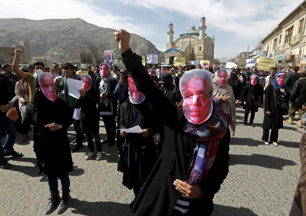Women in Kabul march in protest of the killing of the woman known only as Farkhunda, who was publicly beaten to death after she was falsely accused of burning a Koran.