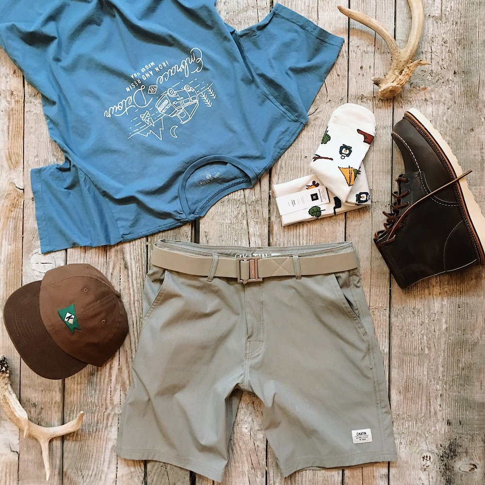 Richer Poorer Anderson Camping Crew Socks  - $12   Katin KFlag Hat  - $30   Arcade Guide Belt in Khaki  - $30   Iron & Resin Embrace the Detour Tee  - $36   Katin Crest Hybrid Trunk  - $62   Red Wing Heritage 8883 Classic Mocs  - $279.99