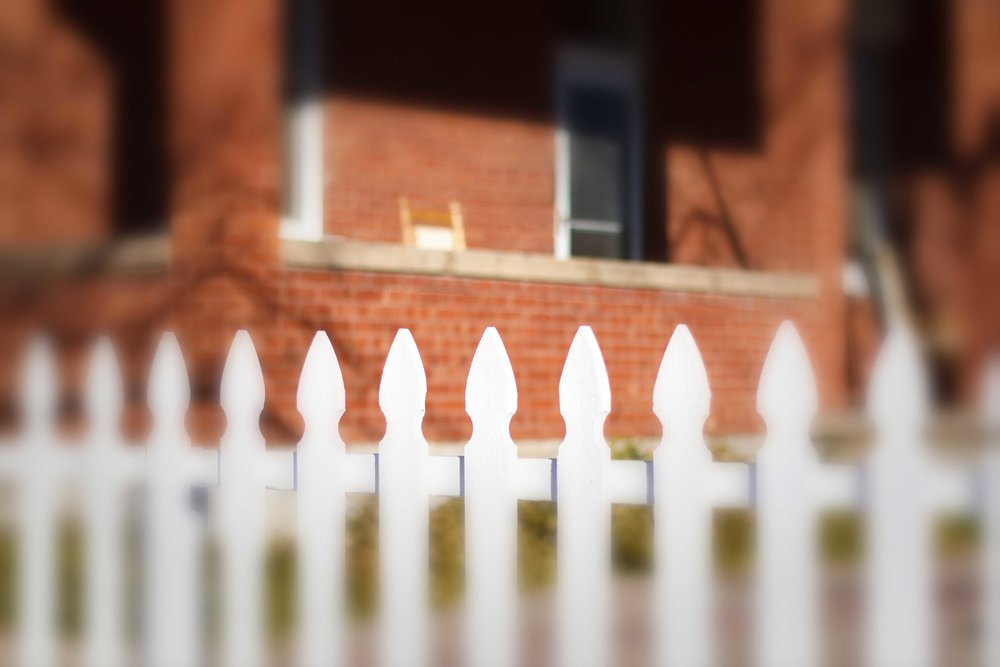vernacular-architecture-tradional-home-white-fence-red-brick-house-porch