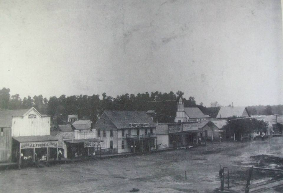 "First know photo of ""Poteau Switch"" circa 1875. Notice rail-bed at bottom left. This original townsite area (aka. Old Town) was destroyed by fire in 1890. The downtown center moved to a new Main Street called Dewey Avenue. See the progression above."