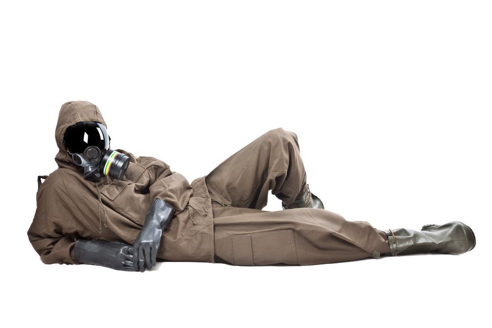Person-Lying-Down-Hazmat-Suit-Toxic-Building-Materials.jpg