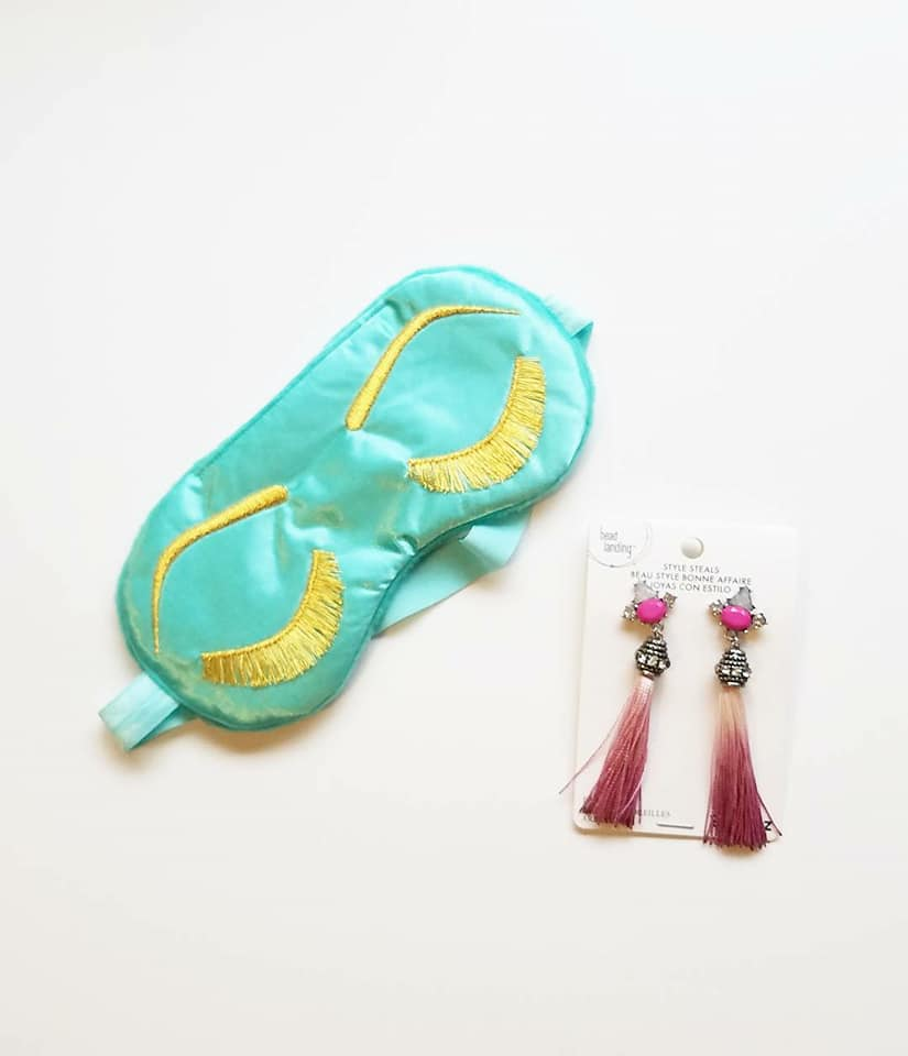 I bought the Holly Golightly-esque sleep mask off of Etsy and I found the tassle earrings at Michaels for $3.50!