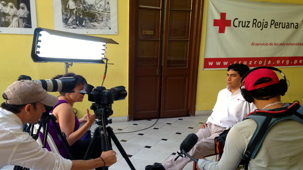 Red Cross Lima, Peru interviewing emergency worker.