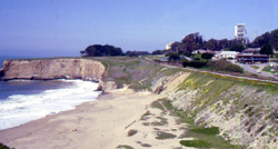 Looking north toward Davenport across San Vicente Beach. The dam-looking structure on the right is the railroad rampart that carried Union Pacific trains to Davenport.