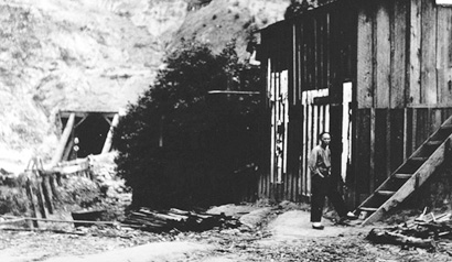 The northern or Wright's end of the Summit Tunnel and one of the Chinese laborers that helped build it, c. 1890.