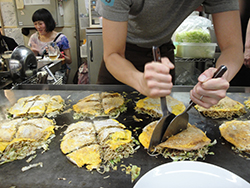 """Japanese food is not just """"little things in little dishes."""" This dish, sometimes called a Japanese pancake, and actually named okonomiyaki was a huge hit in May 2017 and we will be seeking regional variations of this dish."""