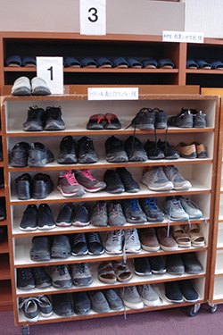 It is customary to remove one's shoes not only in private homes, but also in museums, temples and shrines.  This photo was taken outside a restaurant, and we advise group members to find some slip-on shoes that do not have laces, because it can get very tiresome to untie and tie your shoes a dozen times a day.