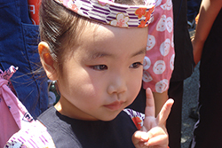 Sanja Matsuri participant.  The Sanja Matsuri also provides a great opportunity to take some very personal photographs, always with permission.  Annie got the little girl's mother's permission to take the photograph.