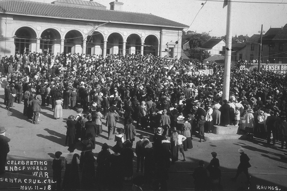 Santa Cruz Post Office, November 11, 1919.  When the crowds came out to celebrate the end of the World War, they were still wearing the flu masks.  If you examine the photograph closely you can see the masks.   CLICK TO ENLARGE