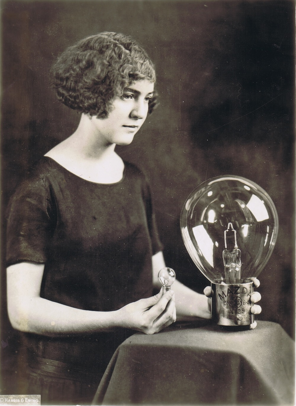 Girl Holding Largest Automobile Lamp, 1924