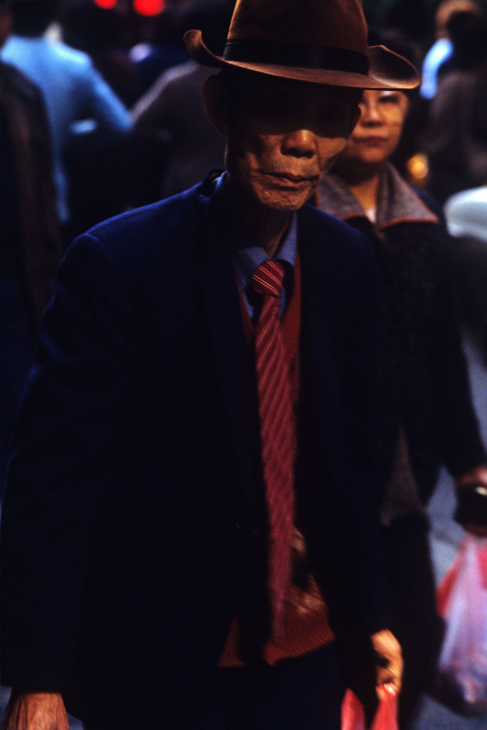 Greg Girard, Man in Hat and Jacket, Wan Chai, 1985.jpg
