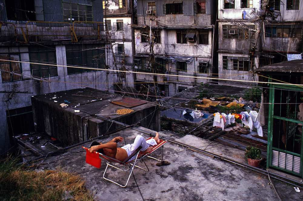 Relaxing on Walled City rooftop, 1989
