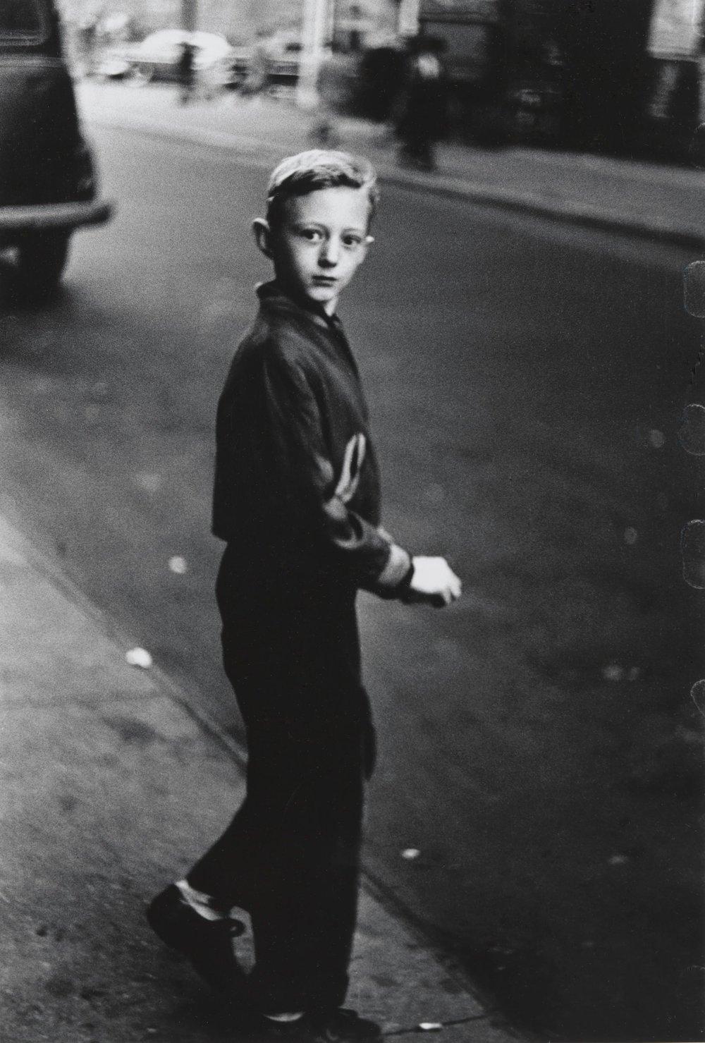 Diane Arbus,  Boy stepping off the curb, N.Y.C.,  1957–58