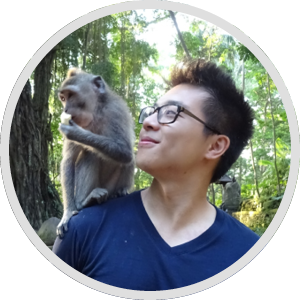Here's a picture of me in Bali with a monkey eating a banana off my shoulder, moments before he bit my finger!