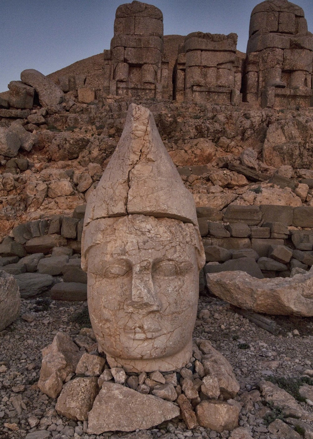 The head of the god Apollo, Mt. Nemrut, Turkey, with the thrones of the gods at the crest of the 7,000 foot mountain.