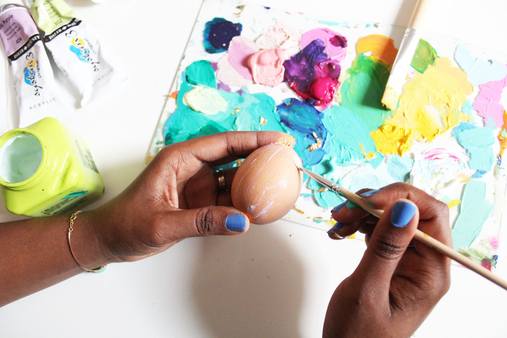 Diy bright brushstroke easter eggs tutorial ettavee with a paint brush cover the full surface of a clean hard boiled egg with glue its nice to give the egg a little time to dry before adding the gold foil ccuart Gallery