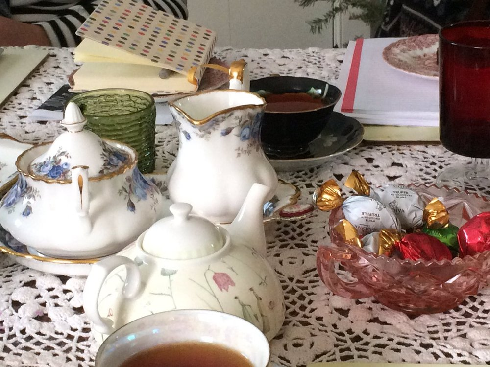 Teapots, notebooks and chocolate. Photo courtesy of @tarynblackthorne