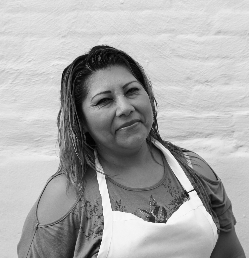 "Patricia Calm, cool, and collected under pressure, Patricia is ""la maestra"" of the grill. Having worked with masa since she was a babe in Puebla, Patricia turns out 12"" tortillas without breaking a sweat - or a perfectly manicured nail. When she's not making insanely delicious signature quesadillas, she loves playing with her grandchildren in Sunset Park, getting new tattoos, and going out dancing."