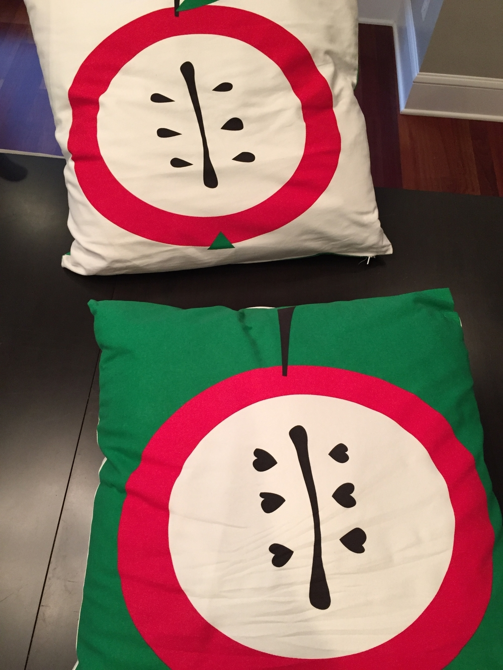 Last year I found these large apple printed pillowcases at Ikea for $5 each. I coated the pillows with Scotch Guard and now they are on the front porch chairs.