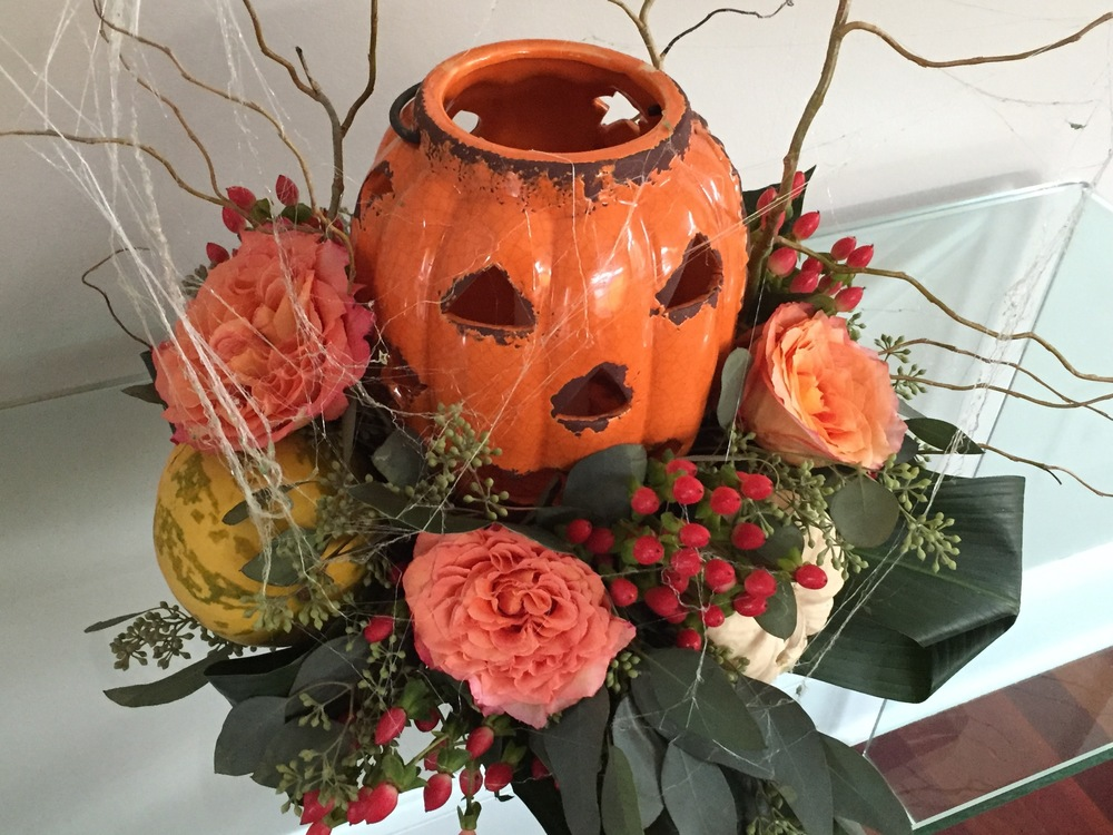 This floral arrangement is great - the pumpkin is ceramic so you can light a real candle inside. They used real whole squash in the bouquets. $50 for identical arrangements from Arts & Flowers. Two arrangements = $107.28