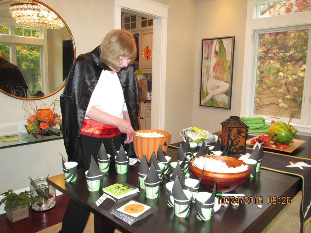 The piano teacher dressed up as a magician and helped put the popcorn into the witches cups. You can see the fingers and Frankenstein watermelon on the table too. Very minimal.