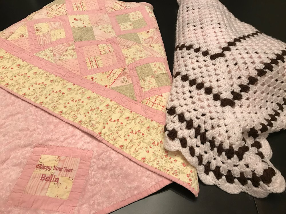 Hub's Nana had the quilt on the left made and gave it to my daughter when she was born. The pink and brown crochet blanket was handmade by the mother of my friend Renee who gave it to me at my baby shower.