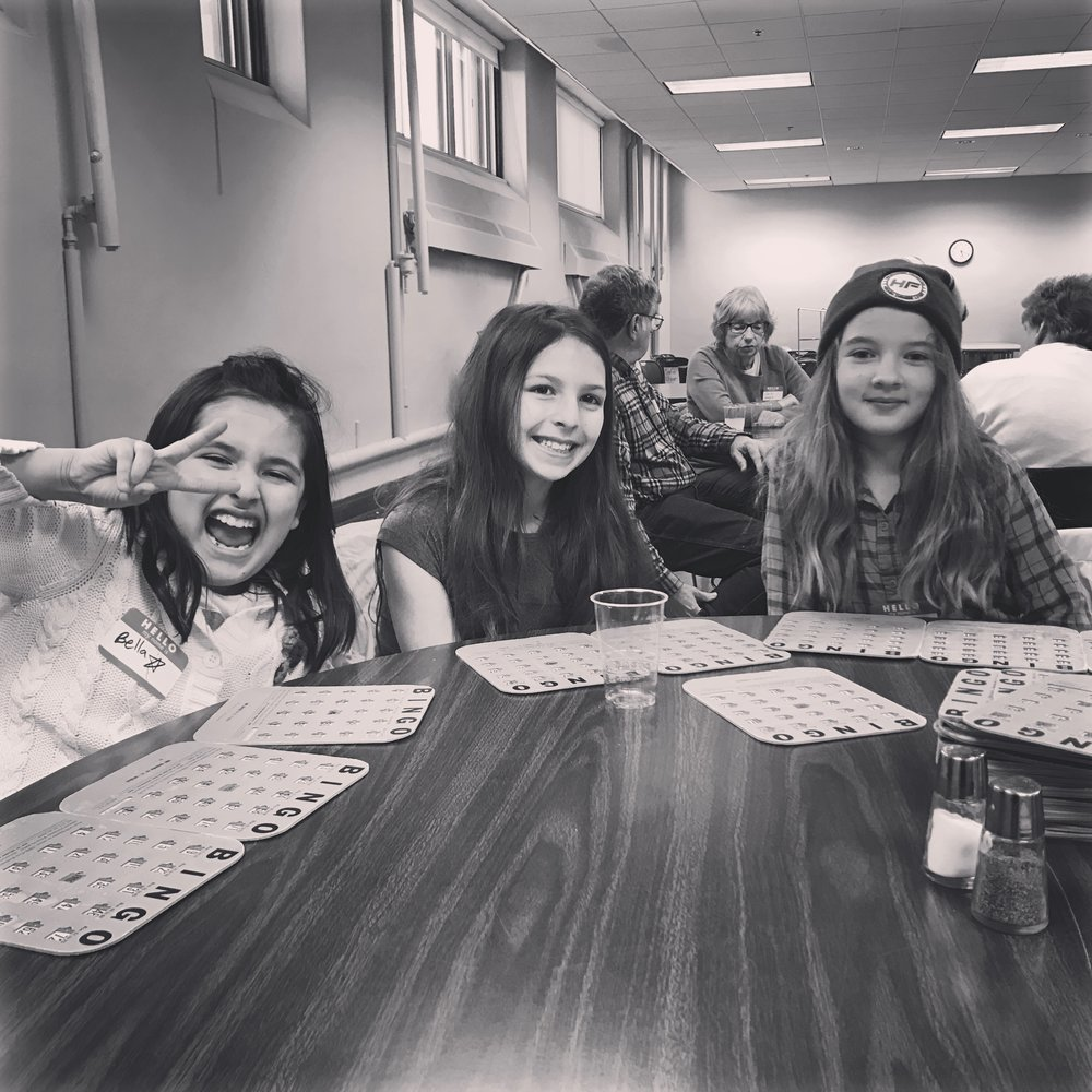 "Instagram Message: The church bingo prizes were mostly an assortment of ""re-gifts"". These girls didn't care, they were in it to win it!"
