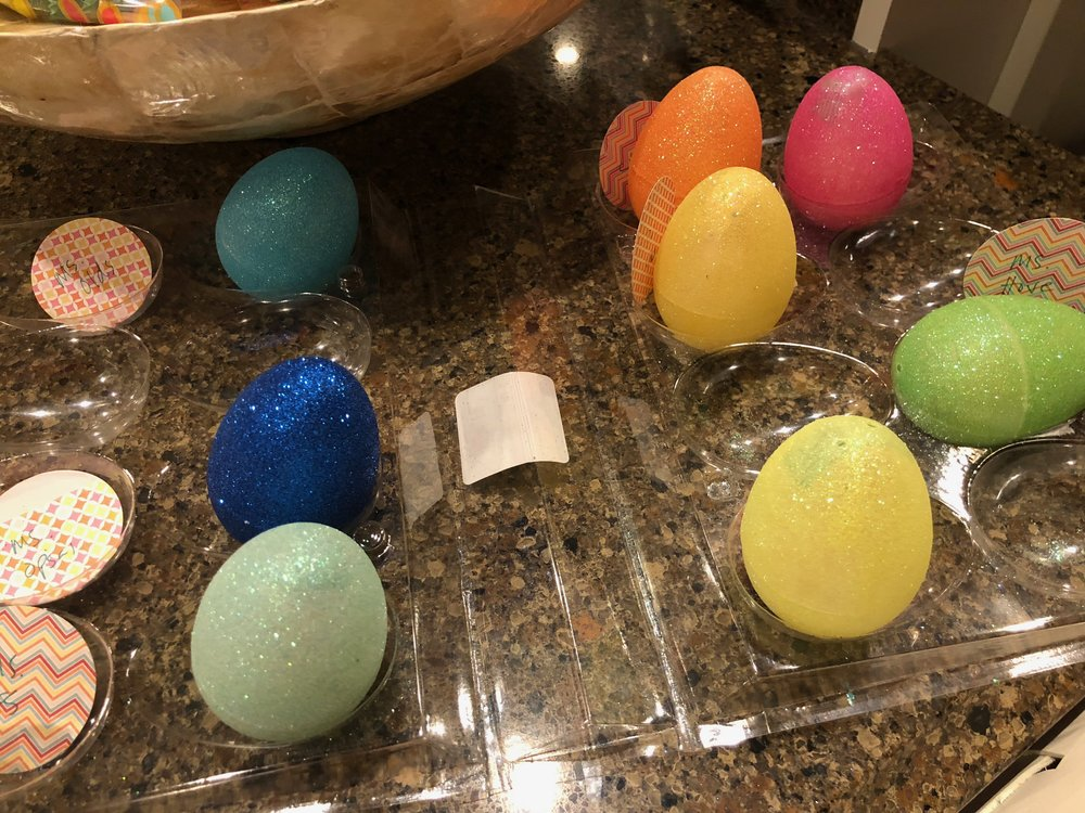 These plastic eggs had four holes - two holes on each half. I used washi tape to seal the holes from the inside. Then I used a strip of washi tape around the egg to make sure both ends stayed together.  We found out that regular plastic eggs worked best because the glitter eggs were difficult to tape together.