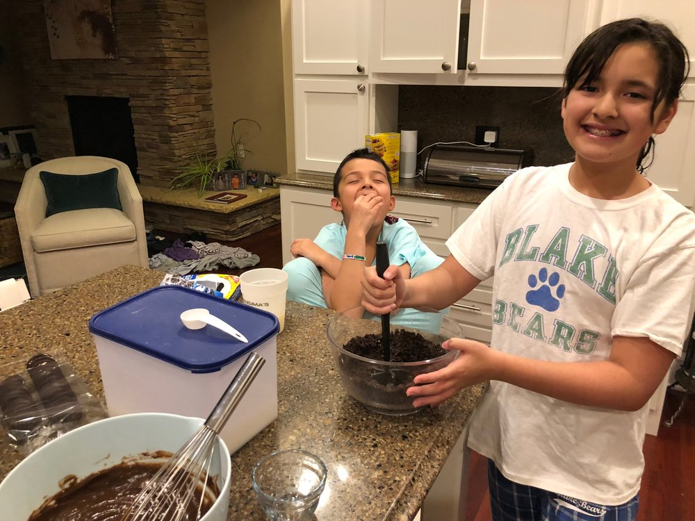 She made the pudding then soon took over making the dirt because he was too busy eating the Oreos that fell out of the bowl.