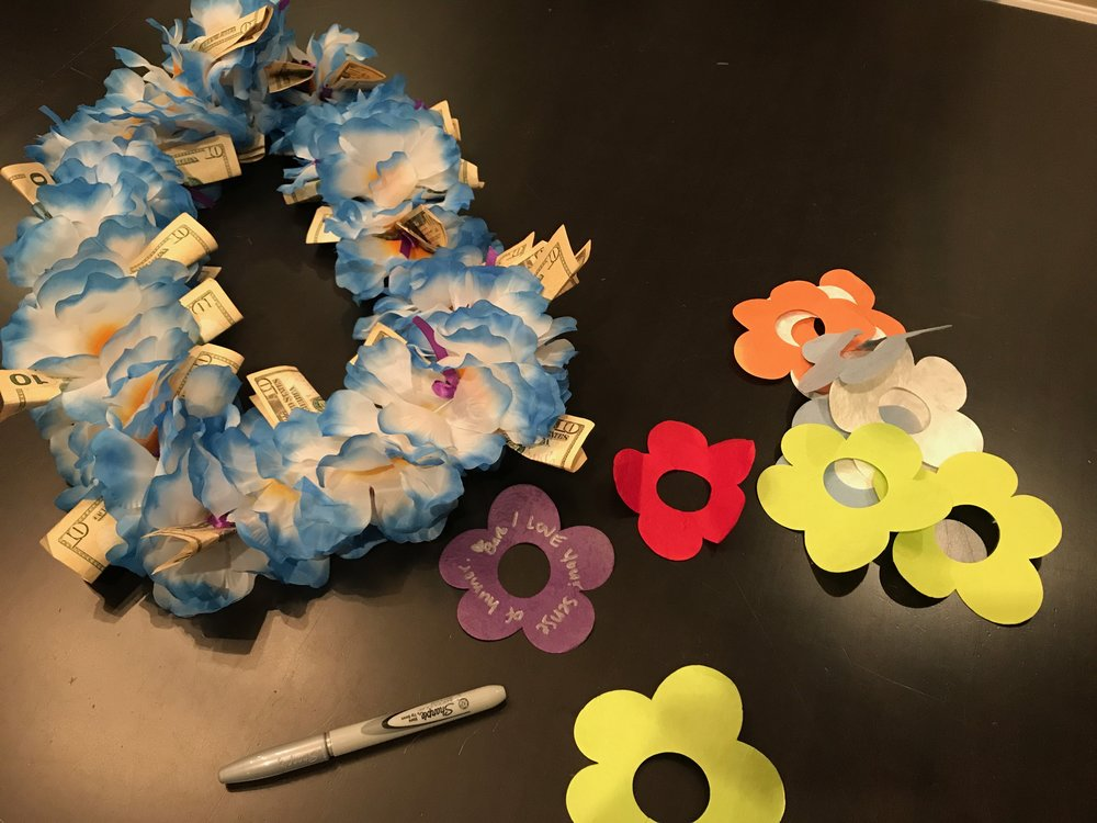 We wrote special notes on flower-shaped paper and added them to our parent educator's End of the Year cash lei. The notes added warmth and a personal touch. See this  post .