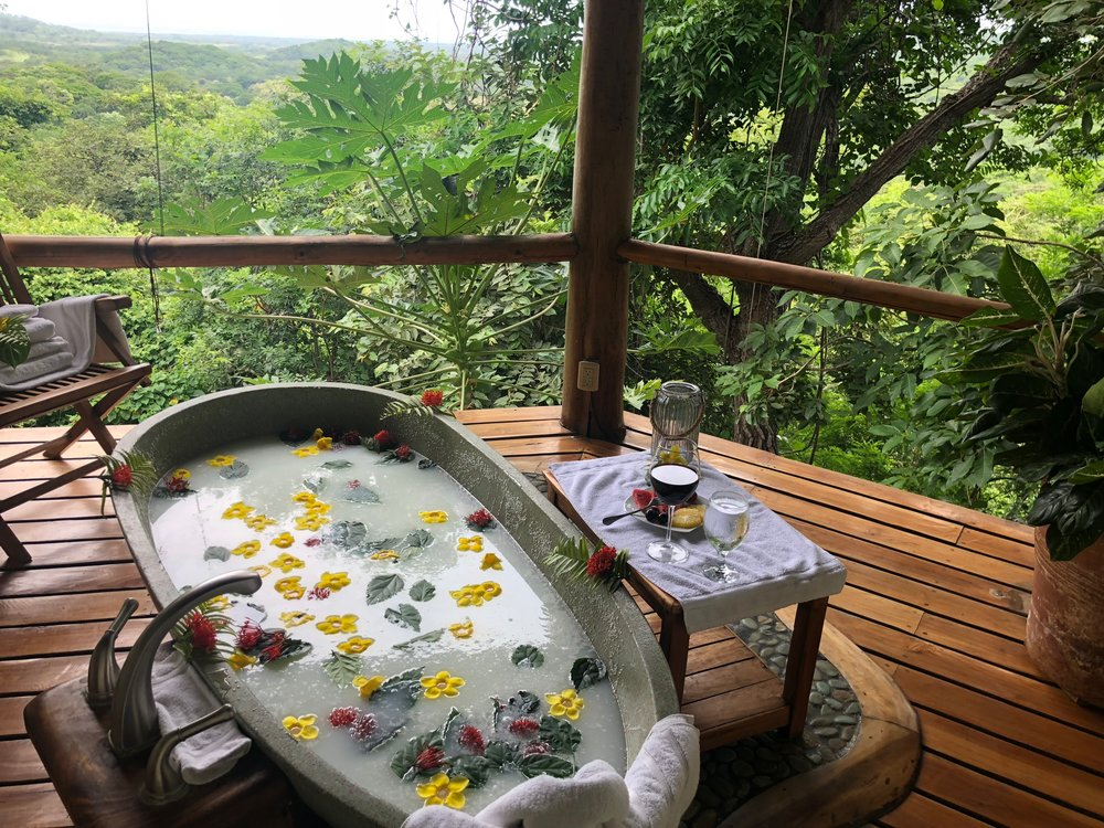 Note the view, the coconut milk bath and the wine with fruit. Such a peaceful soak.