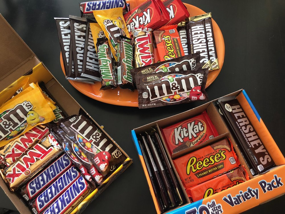 Hell yes, we're giving out regular full size candy bars! I end up giving 5 mini candy bars to every kid when we're all better off having a full size candy bar. Besides, Costco will take back boxes of candy that we don't use.
