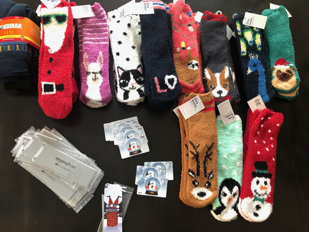 Look, Amazon makes gift cards that can be used as book markers after they are redeemed. Yaaaas! The kids chose the Old Navy sock design ($1 on Black Friday) that best matched each teacher, piano and ballet teacher etc.