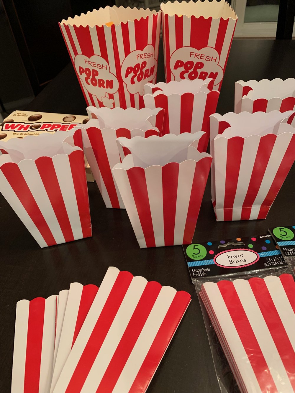The small popcorn containers will be given to teachers but the two larger ones with print are reserved.