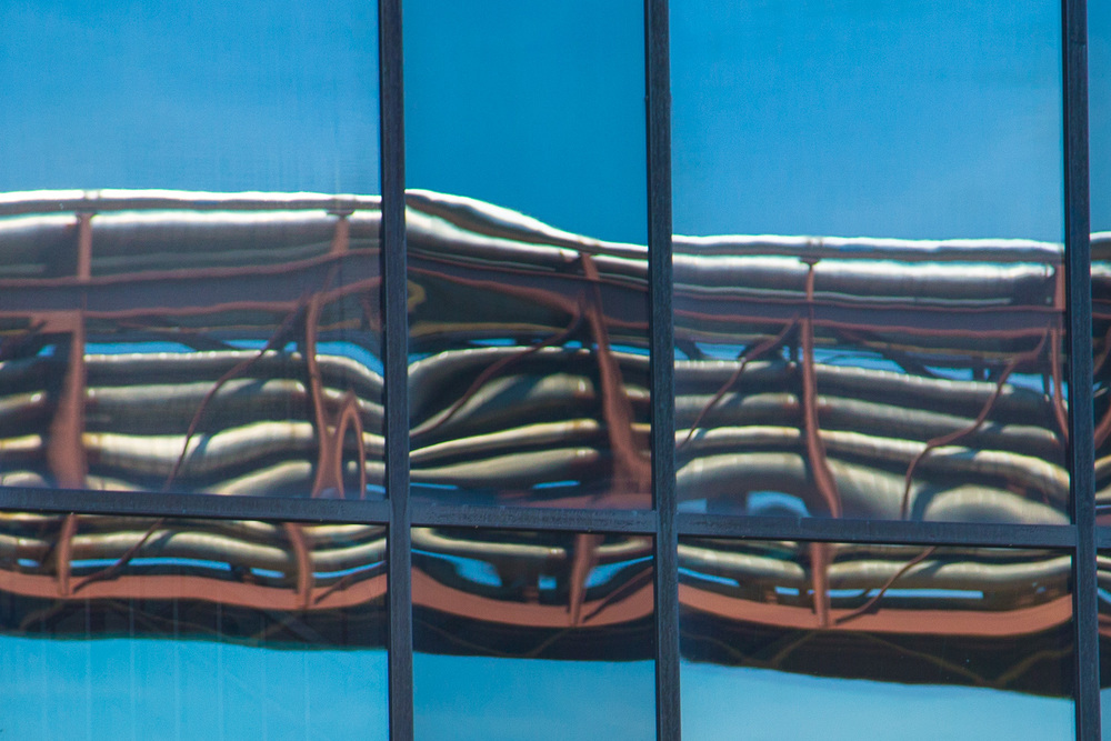 I love the reflection of these pipes and blue sky on one of the windows at the brewery.