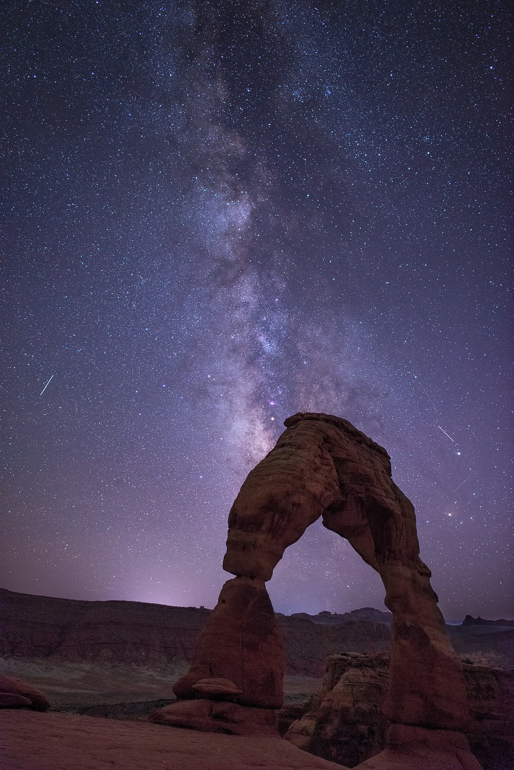 The Milky Way above Delicate Arch, in Arches National Park.
