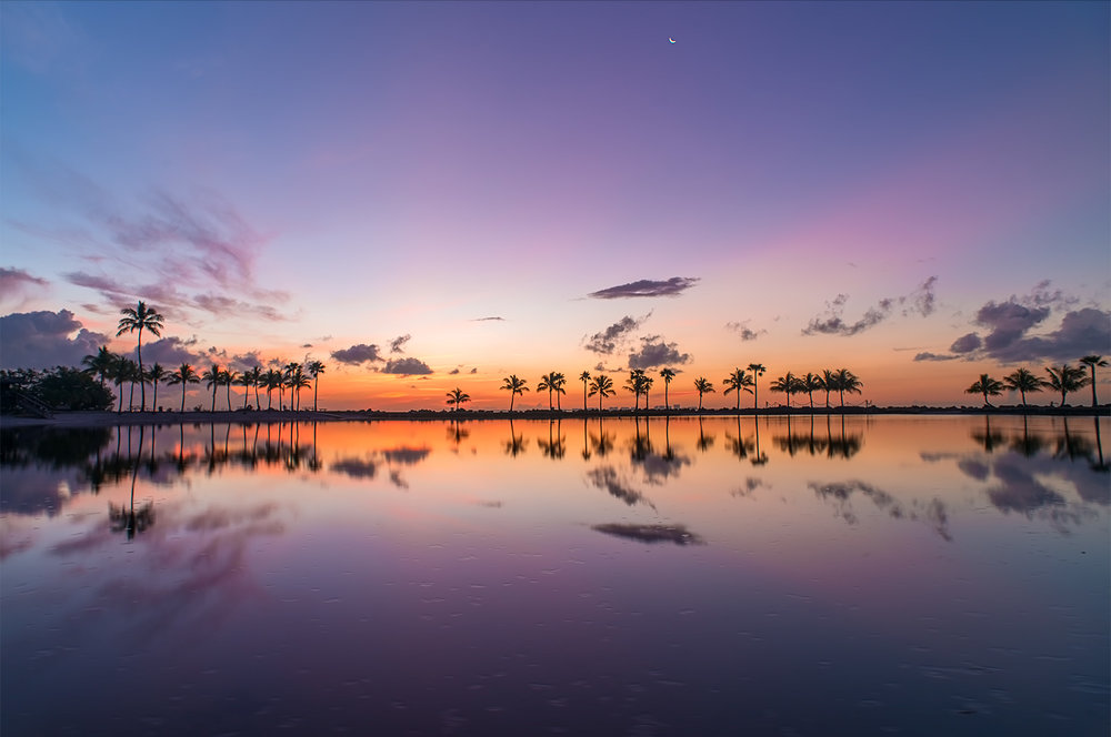 Sunrise at the clam, still waters of Matheson Hammock Beach Park.