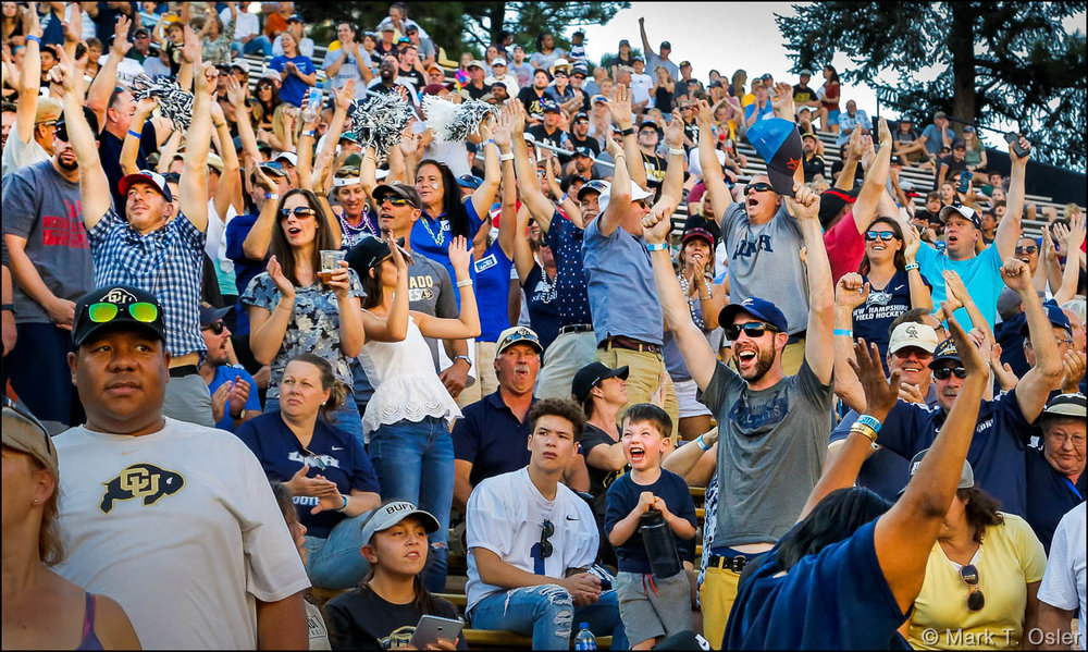 The UNH fan section at CU's Folsom Field celebrates a 71-yard touchdown strike from UNH quarterback Christian Lupoli to Neil O'Connor  in the third quarter, narrowing the score to 38-14, following the extra point.