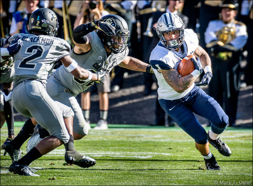 UNH wide receiver Malik Love (#1) is tackled by CU inside linebacker Rick Gamboa (#32) and cornerback Ronnie Blackmon (#2) after making a first down in the second quarter.