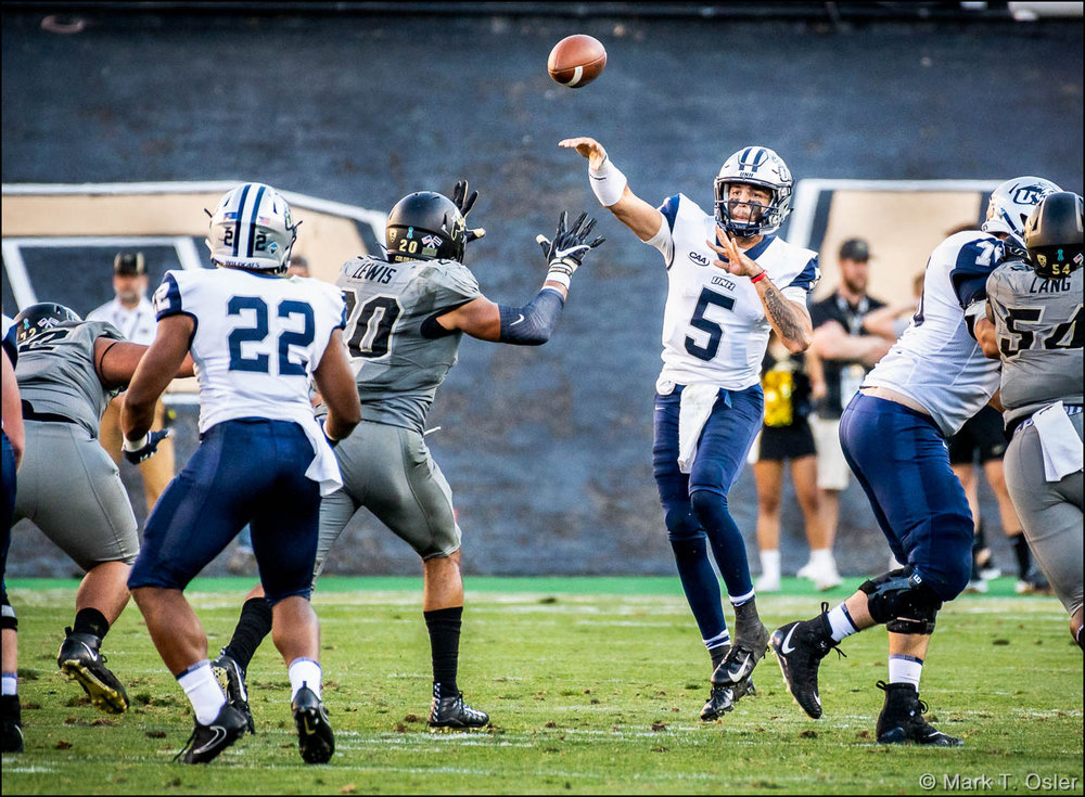 UNH quarterback Christian Lupoli (#5) completes a pass to running back Evan Gray (#22) early in the fourth quarter.