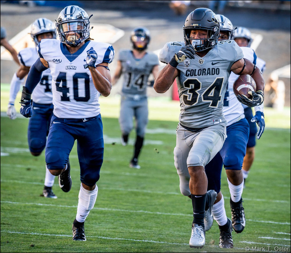 UNH safety Pop Lacey (#40) and his UNH teammates chase CU tailback Travon McMillian (#34) in vain as McMillian races down the west sideline for a 75-yard touchdown run on the first play of the third quarter.