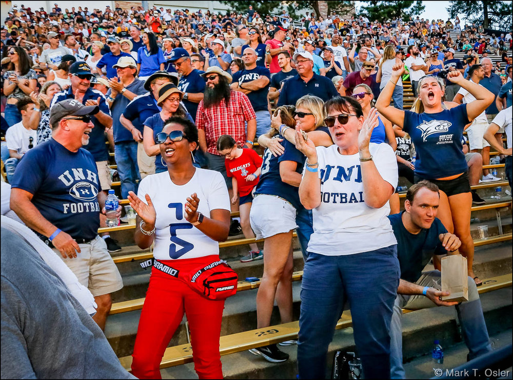 UNH fan displayed enthusiasm for their team throughout the game, in spite of the lopsided match-up, won 45-14 by CU.