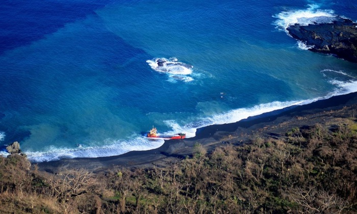 A ship washed away is seen beached along Tanna Island.
