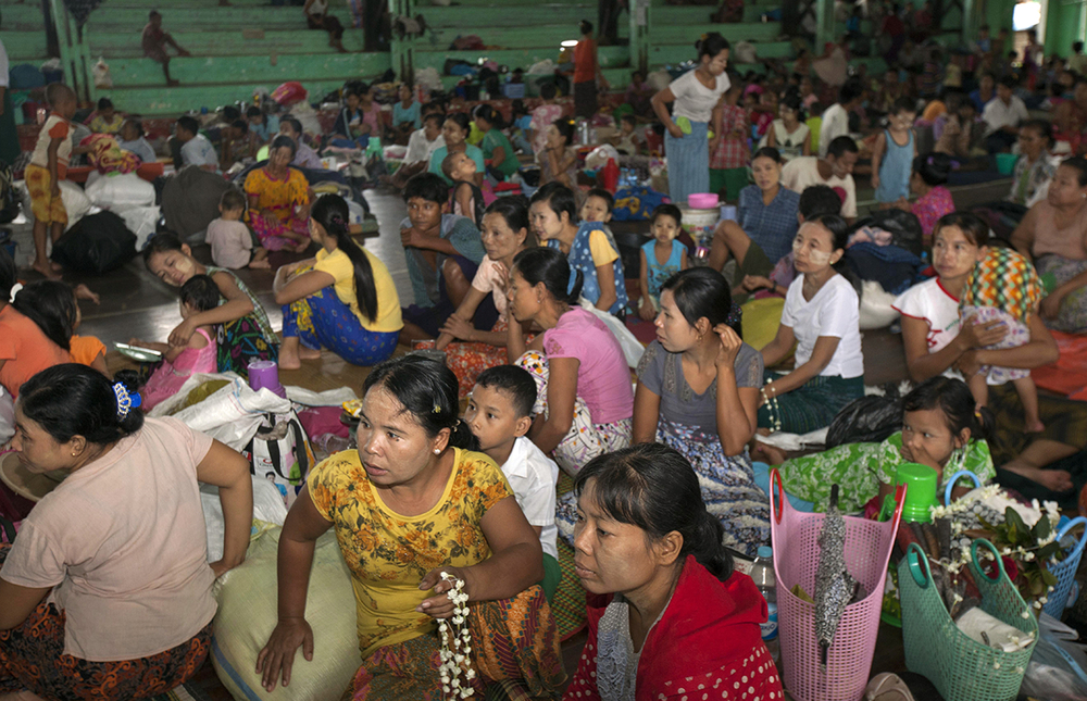 Flood victims take shelter at an indoor stadium, Myanmar